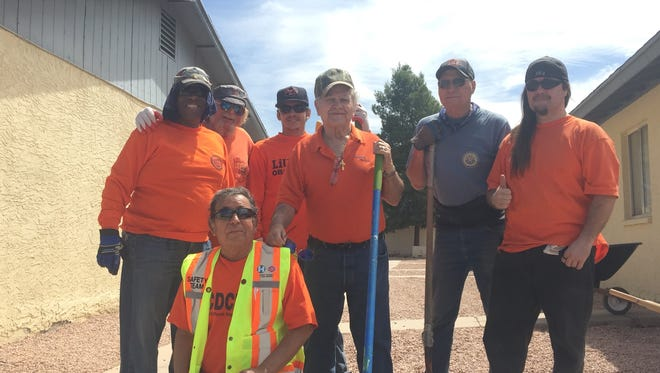 Some of the laborers from the Laborer's Local Union #383 volunteered their time to paint and landscape Whispering Sands affordable housing in north Phoenix, April 27, 2016.