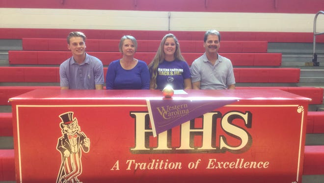 Hendersonville senior Amy Yarborough signed with the Western Carolina University track program on Thursday. She is flanked by her parents, Terry and Kelly, and her brother, Alex.