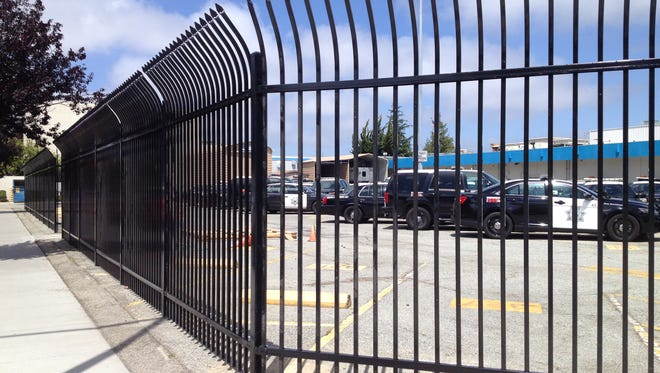 Fencing is going up around the Salinas Police Department parking lot.
