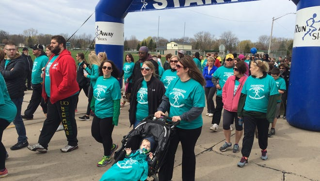 A 5K for Suicide Awareness drew almost 1,000 people to Oshkosh on Saturday for an event meant to raise awareness and provide a network of support.