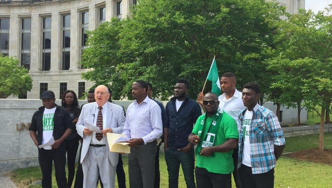 A group of Nigerian students and their attorneys gather outside the federal courthouse in Montgomery, Ala. after seeking legal action against Alabama State University.