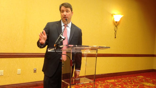 Greg Adkins, the president and chief executive officer of the Tennessee Hospitality & Tourism Association, talks to a room of about 70 hospitality industry professionals opposed to a proposal by Rutherford County Mayor Ernest Burgess to double the hotel tax to 5 percent.