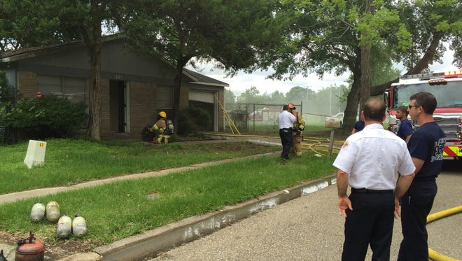 A home received moderate damage Tuesday when it caught fire from an improperly discarded cigarette.