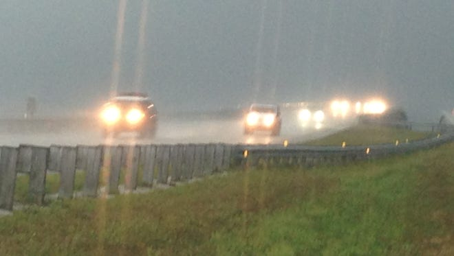 Rain makes for a soggy commute over Pineda Causeway in Melbourne on Wednesday morning.