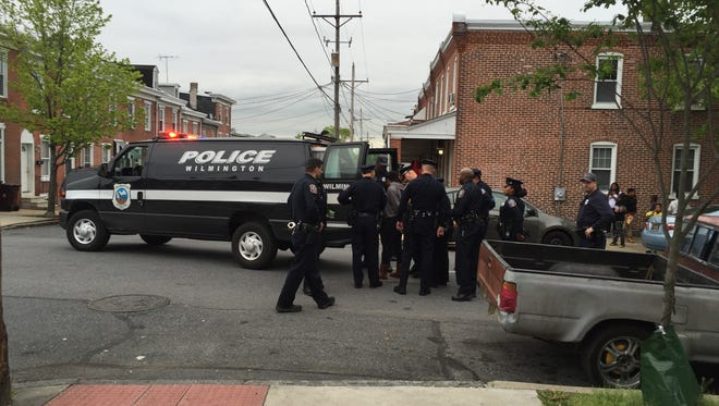 Wilmington police take a woman into custody after a verbal altercation with police.