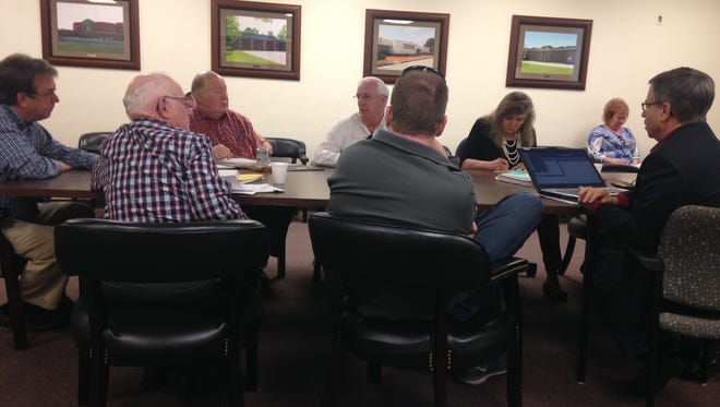 Members of the Madison County Budget Committee listen to the Buddy Gresham, the Madison County Sheriff's Office budget director at Friday morning's meeting.