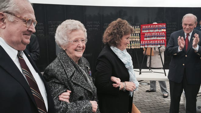 Marie Liston,  center, is presented with a New Jersey Distinguished Service Medal at the Vietnam Veterans Memorial in Holmdel on behalf of her brother, Neil Lucey of Perth Amboy, a WWII Navy Seaman who perished in the attack on Pearl Harbor. with Liston is her son, Edward Liston, and daughter, Peggy Pingicer.