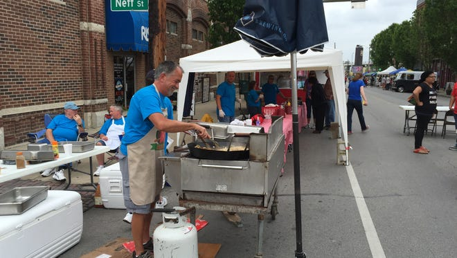 Volunteers for the Tarum Shrine are among non-profit organizations preparing food at the Taste of Italy in 2015.