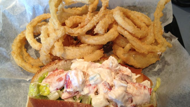 Steamers' lobster rolls have big chunks of lobster in a light dressing that sit in softly toasted and buttered bread buns just like in Maine.