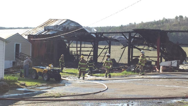 Firefighters at the scene of a fire at 184 Page Brook Road in Whitney Point.
