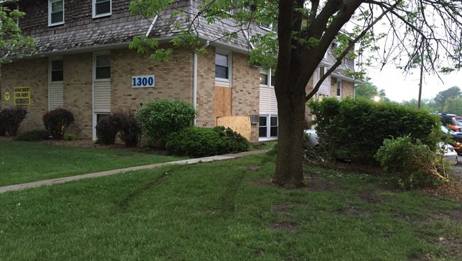 A woman crashed her car into a Drake neighborhood apartment.