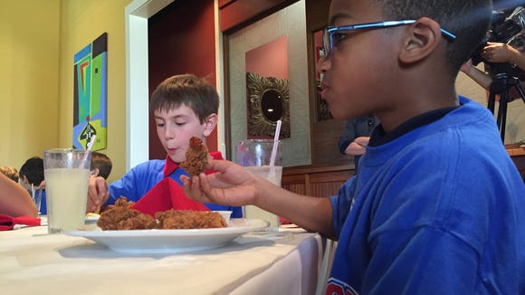 Third graders Gerald Singleton Jr., right, and Cole Babineaux eat lunch at Bailey's Seafood & Grill Tuesday. The Broadmoor Elementary students were treated to the lunch for earning straight As this school year.
