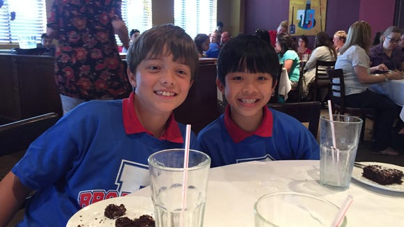 Fourth graders Carter Richard, left, and Ryan Le received special recognition Tuesday during lunch at Bailey's Seafood & Grill for earning straight As from second through fourth grade at Broadmoor Elementary. In addition to lunch at the restaurant with other straight A students, they received gift certificates to Bailey's to dine again with their families.