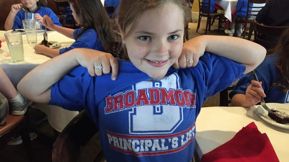 Broadmoor third grader Gabrielle Carney proudly shows
