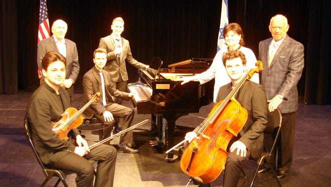 Front Row with instruments -- left to right Violinist Asi Matathias and Cellist Gabriel Schwabe.   Second row -- Howard Levy, Pianist Victor Stanislavsky, Nancy Ditlove, and Bernard Reiter.  Third Row -- Singer Omer Shaish.