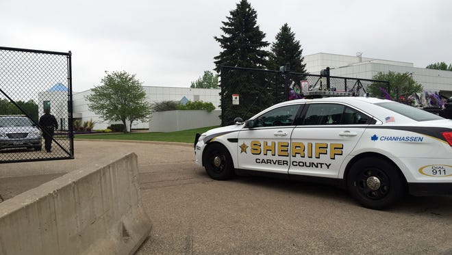 A Carver County sheriff's vehicle enters through the gates of Prince's Paisley Park home and studio in Chanhassen, Minn., Tuesday, May 10, 2016. A Minnesota doctor saw Prince twice in the month before his death, including the day before he died, and prescribed him medication, according to contents of a search warrant that were revealed Tuesday even as authorities revisited the musician's estate.