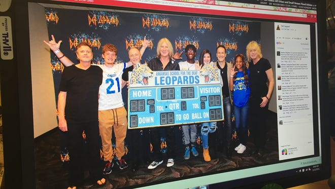 The photo of Def Leppard posing with Arkansas School For the Deaf 'Leopards' has been shared more than 1,000 times as of Thursday morning.