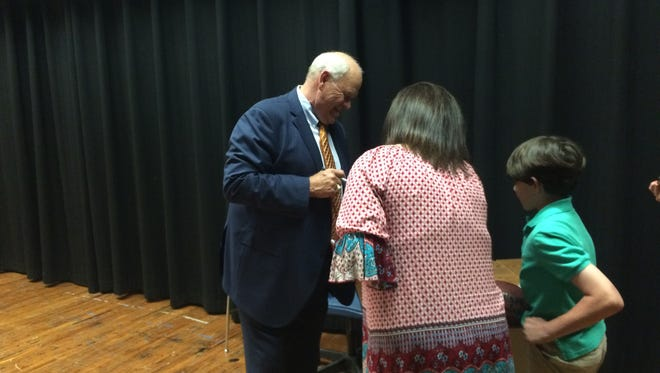 Former UT football coach Phillip Fulmer signs autographs for fans before speaking at Bolivar High School on Thursday.