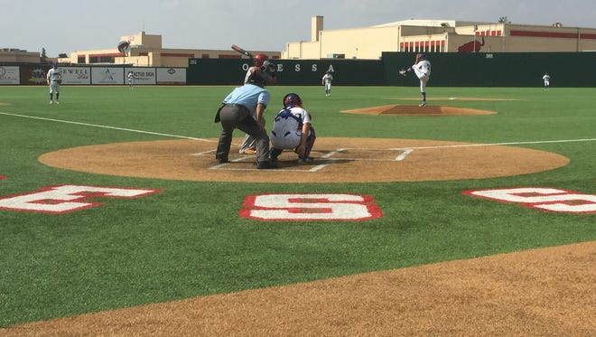Abilene Cooper pitcher Caleb Freeman throws a pitch against a Jefferson batter. The Cougars defeated the Silver Foxes 5-0 in Game 1 of the best-of-three series for an area title in the Class 5A state baseball playoffs.