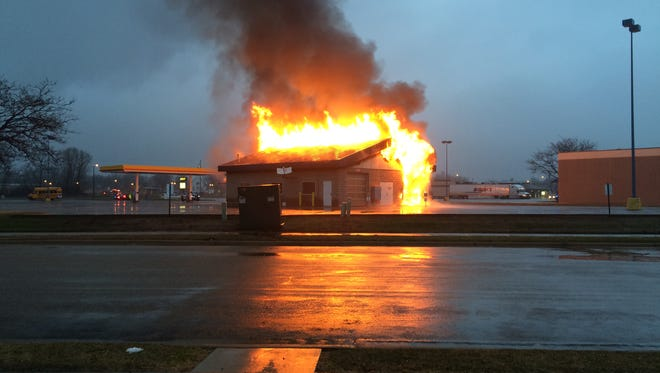 Flames destroy the Rapids Mega Car Wash the morning of April 6. It can take weeks to do an investigation into the cause of a fire like this one, according to a police detective.