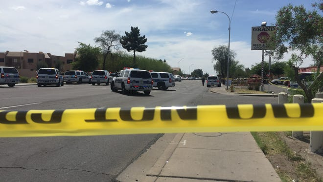 """Phoenix police closed off McDowell Road west of 35th Avenue for an active shooting scene during which an officer was hurt and a suspect was """"down,"""" police said."""