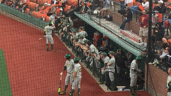 Oregon players outside the du dugout before Game 1 of the Civil War series Friday at Goss Stadium in Corvallis.