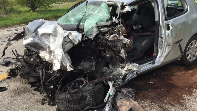 Silver Volkswagen crushed after crashing into tractor-trailer on Ohio 53. The driver of the car died instantly.