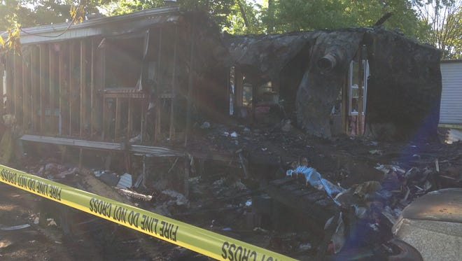 A Dillsburg mobile home is seen the morning after a fire ripped through its roof.