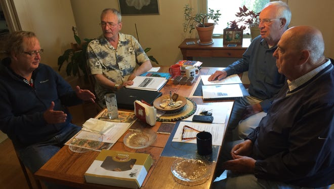 """Retired teachers Jim Grinsel, Jim Kraft, Al Solomonson and Henry Osswald talk about their booklet """"The New West High School: Educational Change in Wausau 1970-95."""""""