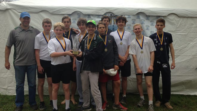 Members of the Novice Men's 8+ rowing team pose with the NY State Club Champion trophy and gold medals.