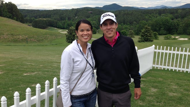 Natalie The, left, and her husband, pro golfer Matt Davidson. Both are Furman graduates, and The teaches at the university, which allows Matt to participate on the Web.com Tour, a PGA Tour developmental league.