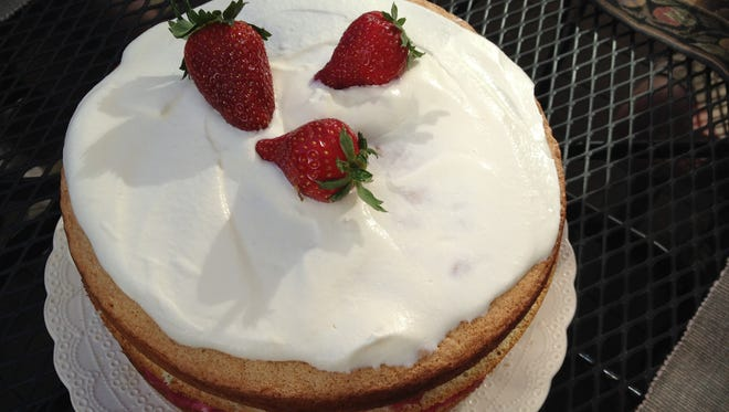 Rhubarb-strawberry whipped cream cake celebrates the overlap of rhubarb and strawberry season in Vermont.