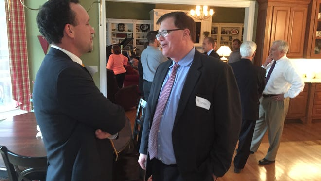 SC Rep. Bruce Bannister of Greenville, left, House majority leader, confers with Rep. Jay Lucas of Hartsville, speaker of the House, during a fundraiser Thursday for Rep. Wendy Nanney of Greenville.