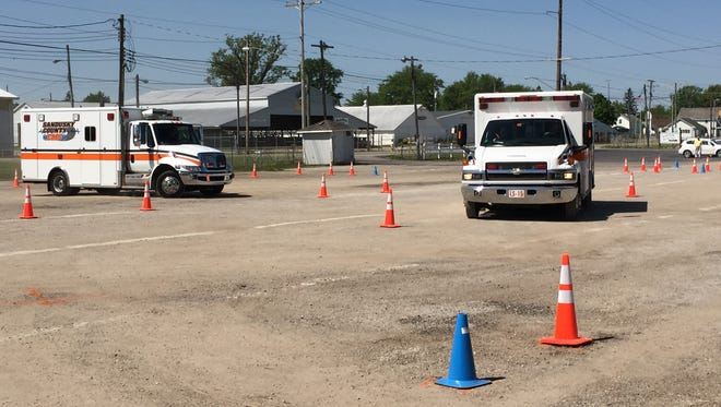 Sandusky County EMS personnel tackle an obstacle course set up at the Sandusky County Fairgrounds in order to stay sharp in maneuvering the ambulances.