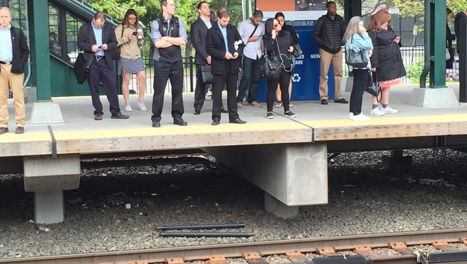 People wait for a New York City-bound train at the Tarrytown Metro-North station on Thursday, May 19, 2016.