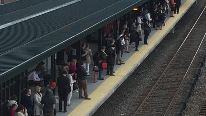 Commuters wait for a Manhattan-bound train at the Tarrytown station, May 19, 2016.
