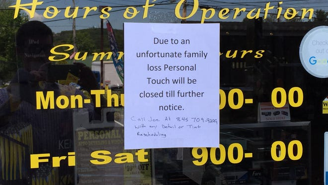 A sign outside Personal Touch Auto Span and Window Tinting in Pomona on Thursday. The owner, Alberto Rivera, was killed in a motorcycle crash the night before.