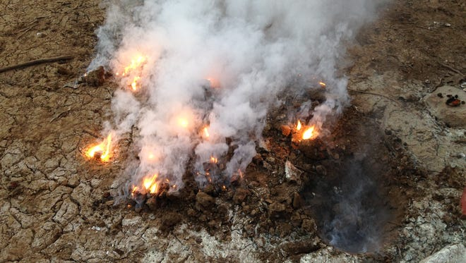 First responders captured this image of burning soil on the shore of Enka Lake during the April 26 explosion.
