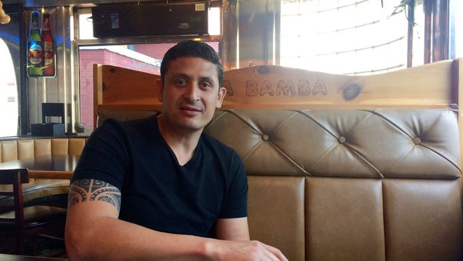 In this May 19, 2016 photo, Jesus Macias relaxes after a shift at La Bamba Mexican restaurant in Greensboro, Macias owns the restaurant and said he and his waiters rely on tips from visitors to the Greensboro Coliseum Complex to make ends meet. Several events scheduled at the Greensboro Coliseum Complex were cancelled in protest over North Carolina's news LGBT law. That has hurt local business like restaurants, local unions, bars and even community groups, caught in the crossfire of the national debate over LGBT rights.