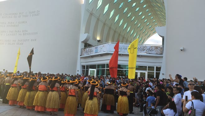 Members of I Fanlalai'an chant in front of the Guam Museum for the opening of the Festival of Pacific Arts visual arts exhibit on May 25.
