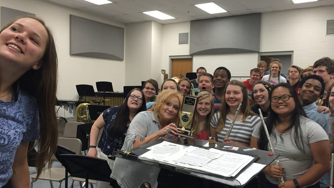 Students in Donnell Lastine-Chopp's band class pose for a picture after receiving the award for best fight song.