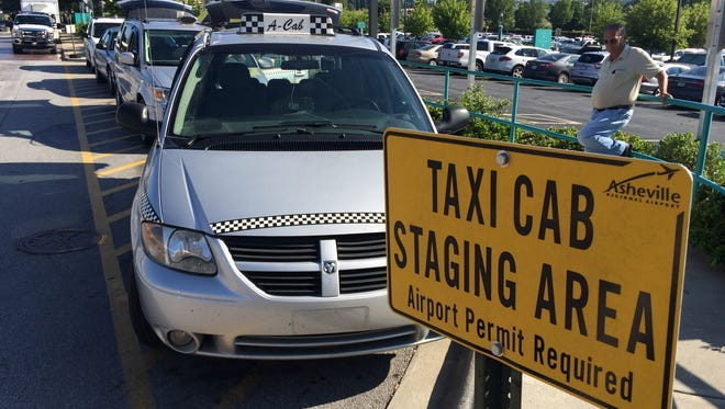 Uber is going through the permitting process that would allow its drivers to pick customers up at Asheville Regional Airport, a move taxi drivers  believe the airport should not allow.