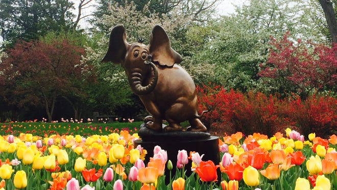 Horton listens and listens for the whisper of the flowers at Dow Gardens in Midland. He is part of a Dr. Seuss exhibit there and at the Midland Center for the Arts.