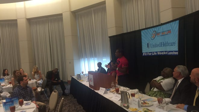 """Robert """"Super-Mann"""" Blount speaks at Thursday's Fit For Life Weekend Luncheon."""