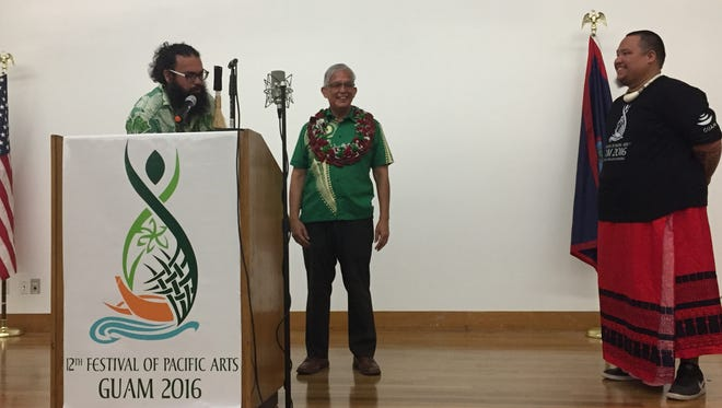 In this May 27, 2016, file photo, University of Guam President Robert Underwood is presented a gift from professor Michael Bevacqua and Kenneth Kuper after Underwood's speech at the Festival of Pacific Arts Indigenous Language Conference. Bevacqua and Kuper are encouraging people to speak only Chamorro on March 5.