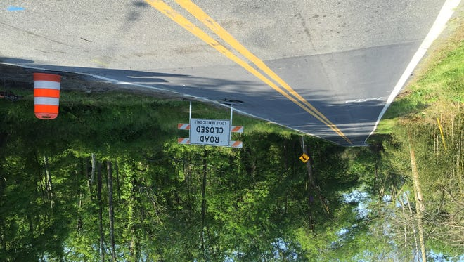 A road closure sign sits at Mill Creek Road near Brackenville Road. Roadwork is planned for several weeks.