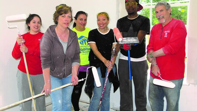 Newfield National Bank employees volunteered for Cumberland County Habitat for Humanity on May 21. The group worked with other volunteers to help construct the latest Habitat dwelling at 221 Yelkca Ave., Vineland (From left) Rae Edam, Diane Dorney, homeowner Iris Acosta, Deanna Colvin, Julius Wilson and Chuck Grova are shown at the construction site.