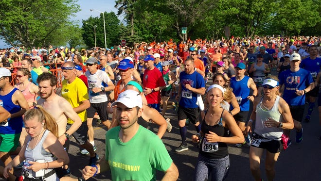Runners start the People's United Bank Vermont City Marathon in Burlington, May 29, 2016.