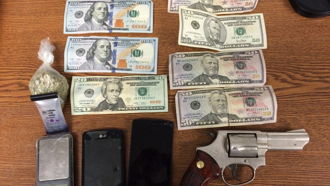 Money, gun, drugs and paraphernalia seized by Waynesboro Police during a traffic stop.