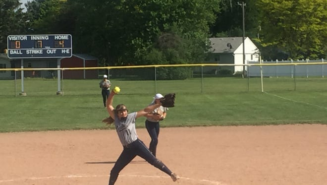 Yale High School pitcher Natalie Keith throws to the Pioneers in the seventh inning of Tuesday's Class B district game.